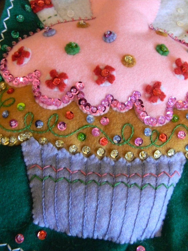 See all that beading and embroidery? Those little peppermint swirls? Those are little appliqued felt pieces fastened with a sequin and a bead. Looks fun, doesn't it? C'mon, doesn't it?